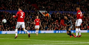 Vitinho slides in to score at Old Trafford.