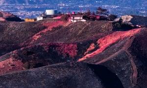 Pink fire retardant liquid is seen on a hill of Agua Dulce near Santa Clarita, California, 25 October 2019.