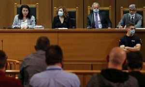 Presiding judge Maria Lepenioti, left, announces the sentences during the trial of leaders and members of the Golden Dawn far-right party.