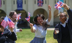 Students at Immaculate Heart high school in Los Angeles, which Meghan Markle attended, sing and dance with US and British flags on 15 May.
