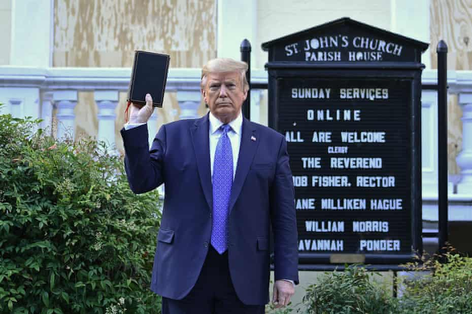 Donald Trump holds up a Bible outside St John's, across Lafayette Square from the White House in June.