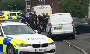 Police raid a property near Quantock Street in Moss Side, Manchester, in connection to last week's terrorist attack