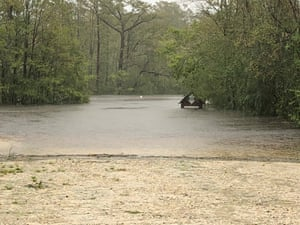 Rice's Creek on Saturday after hours and hours of unyielding rainfall. In the photo from the link above you can see the now submerged parking sign for a sense of how high the water has come.