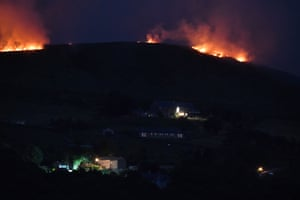 The wildfire sweeps across the moors between Dovestones and Buckton Vale