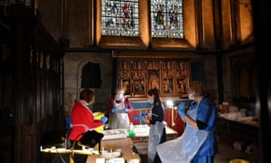 Clinicians and volunteers prepare doses of the Pfizer-BioNTech Covid-19 vaccine today in the Chapel of Saint Michael the Archangel inside Salisbury Cathedral.