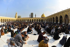 Iraqis perform a mourning prayer for Soleimani at the Great Mosque of Kufa in central Iraq