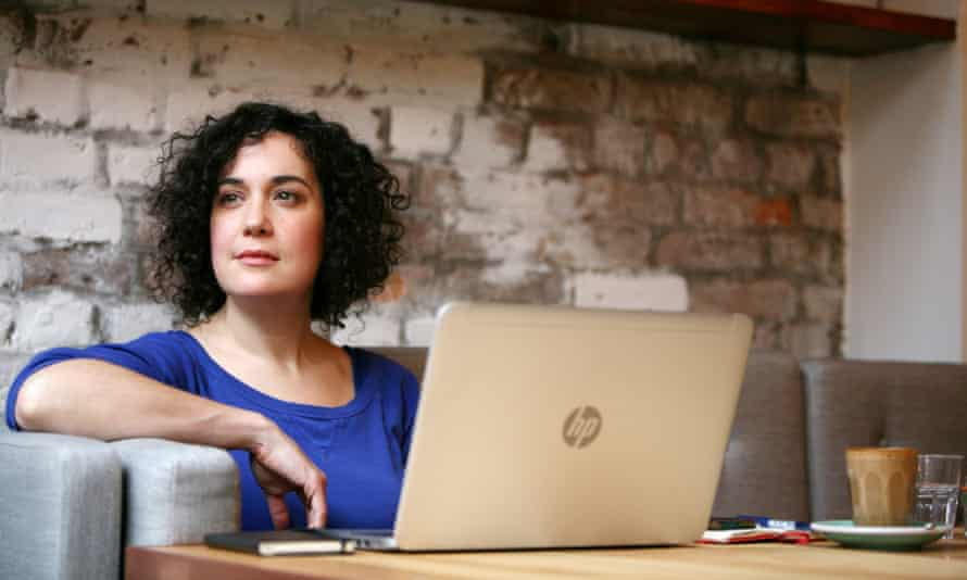 Journalist Kate Feld working in Evelyn's Cafe, Manchester.