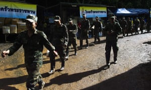 Thai soldiers make their way near the Tham Luang cave as rescue operations continue.