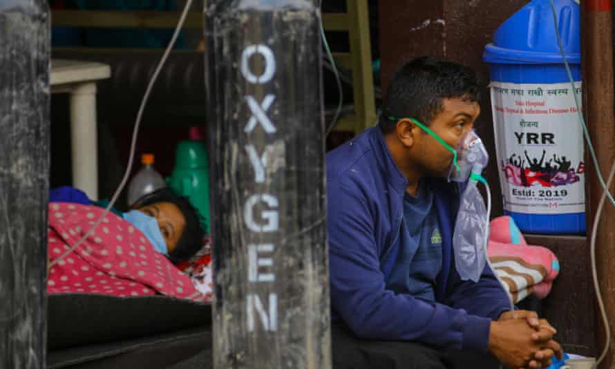 Covid-19 patients receive oxygen as they wait outside a government hospital due to a lack of beds in Kathmandu, Nepal.