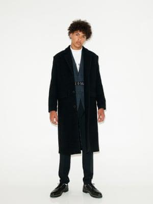 Long black overcoat Weekday, blue checked blazer New Look, white t-shirt Bruta, black trousers Zara, belt Marcelo Burlon County of Milan Far Fetch, black lace up shoes Zara