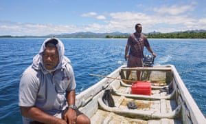 Mosese and Kinikoto collect sea-urchins from the Navakavu Reef, off Fiji's main island, Viti Levu. The tabu, a traditional marker of fishing grounds, prevents over-fishing.