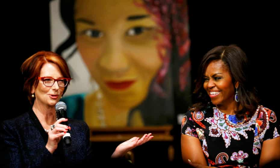 Julia Gillard with Michelle Obama at a conference at Mulberry School for Girls, London.