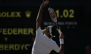Roger Federer gets ready to thwack the ball.