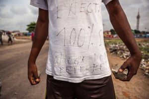 A demonstrator carrying stones during the opposition rally in Kinshasa