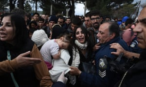 Refugees scuffle with Greek police near the village of Idomeni