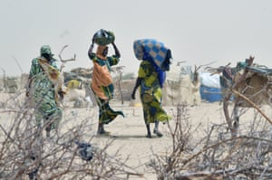 Women arrive in a camp in the village of Kidjendi after fleeing from Boko Haram attacks.