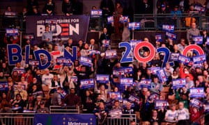 Supporters of Joe Biden hold signs at the Democratic party's McIntyre-Shaheen 100 Club dinner in Manchester, New Hampshire, on 8 February.