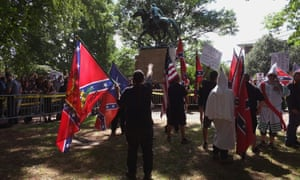 Ku Klux Klan supporters brandish the Confederate flag, statue of  'Stonewall' Jackson.