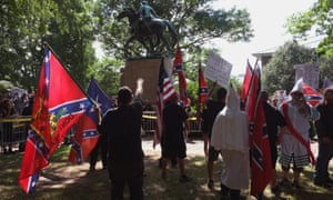 """Ku Klux Klan supporters protest at a statue of Thomas J. """"Stonewall"""" Jackson over the proposed removal of a statue of General Robert E. Lee in Charlottesville."""
