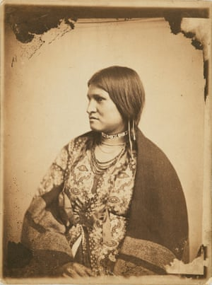 Portrait of a Dakota Sitter, 1862 - 64, wearing a print dress and a blanket as a shawl