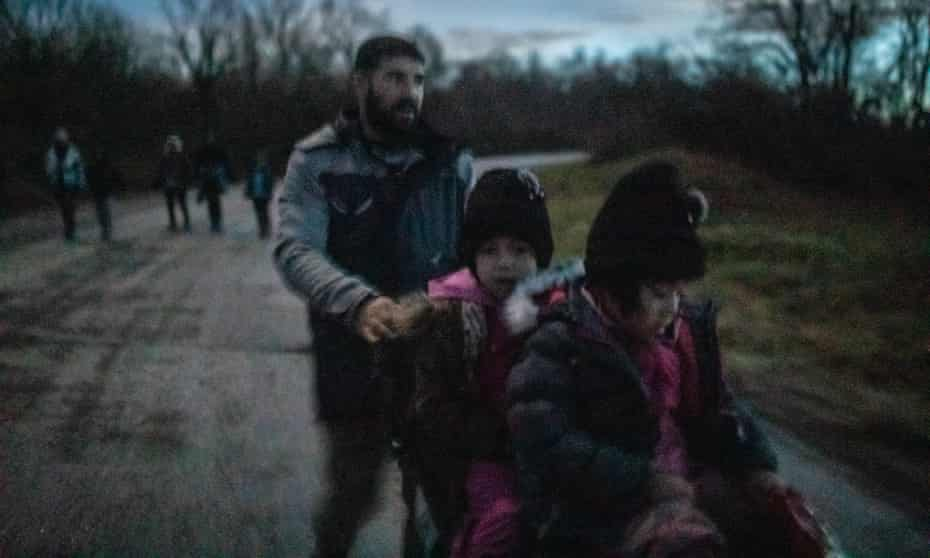 A father from Afghanistan and his children return from the Croatian border after their 54th pushback.