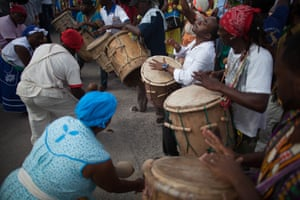Garifuna people, seen here playing drums and maracas