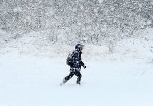 A boy walks to school in Ashford, Kent