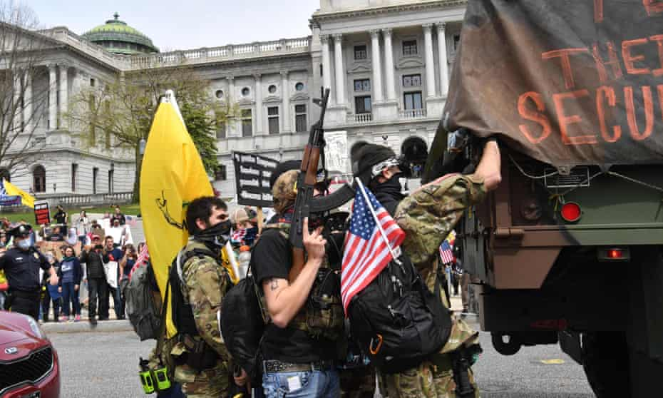 People take part in a 'reopen' protest in Harrisburg, Pennsylvania, on 20 April.