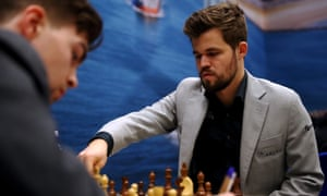 Magnus Carlsen makes a move against Jorden van Foreest in Wijk aan Zee