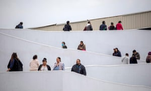 People wait outside a border office in Tijuana, Mexico.