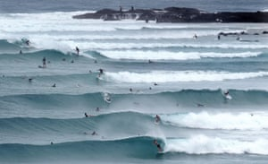 Surfers enjoy the swell at Snapper Rocks on the Gold Coast.