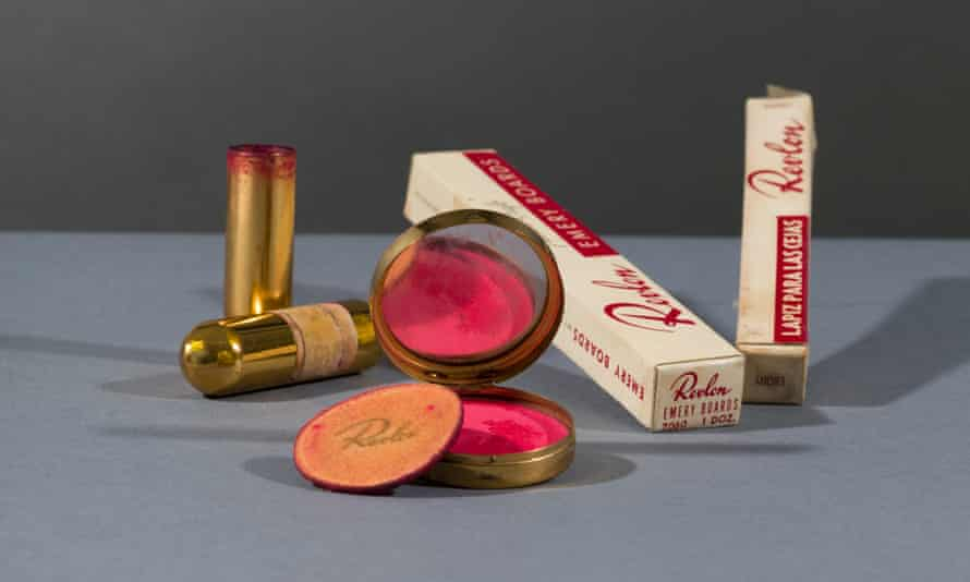 A compact and powderpuff with blusher and lipstick, and eyebrow pencil.