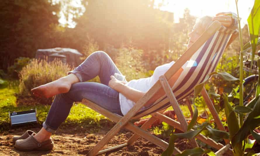 Woman relaxing on allotment Deckchair Gardening Relaxation