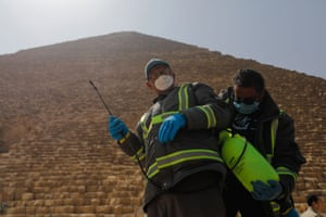 Cairo, Egypt: medical teams prepare to spray disinfectant at the Great Pyramid of Giza
