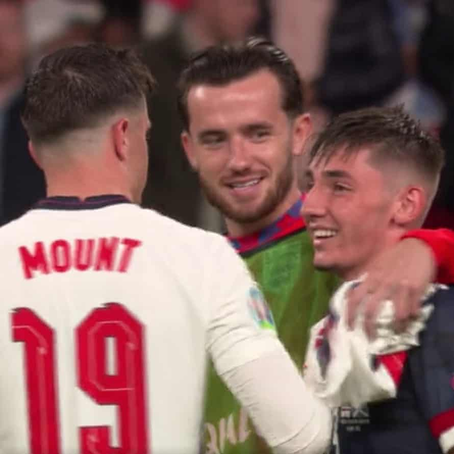 Billy Gilmour gets hugs and hair rustles from Chelsea teammates Ben Chilwell and Mason Mount at the end of the game.