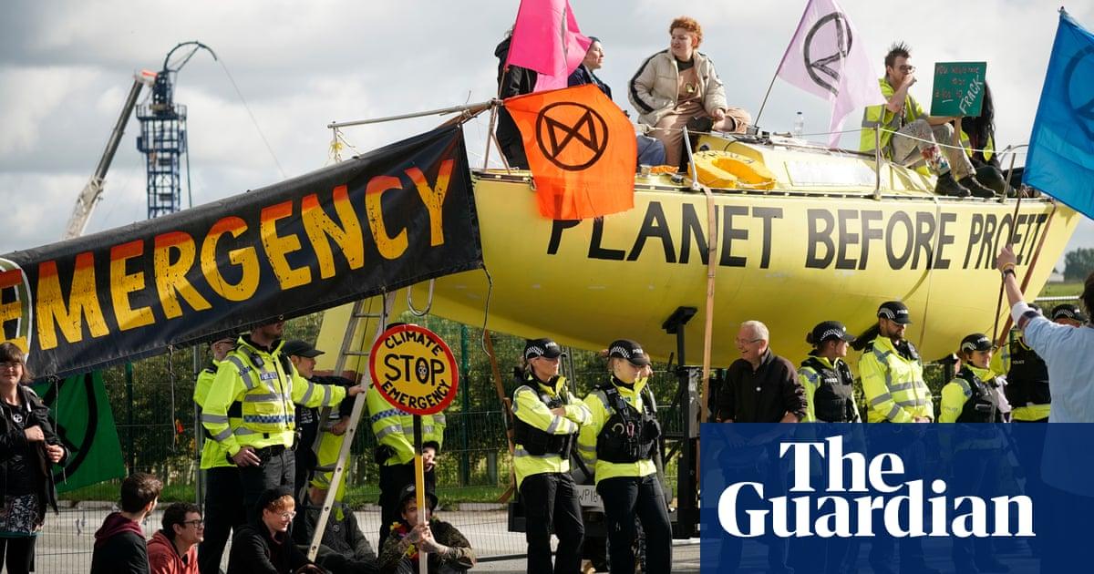 Extinction Rebellion blocks UK fracking site in climate protest - The Guardian