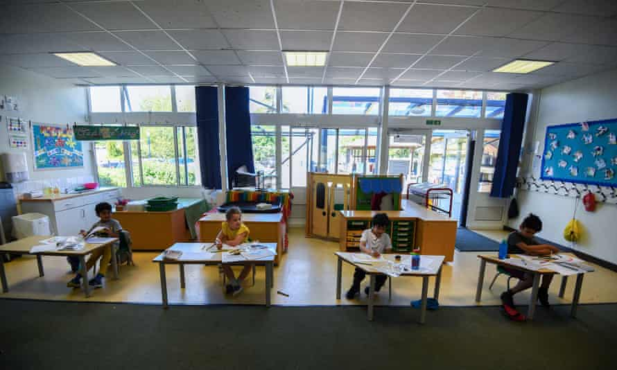 Pupils sit at separate desks at a school in Hampshire as part of coronavirus distancing measures.