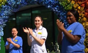 NHS staff unveil a rainbow floral display outside University College hospital, London, on 23 April.