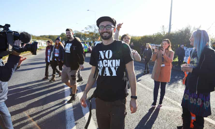 Simon Blevins is welcomed back to the protest site by fellow activists.