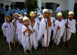 Ahmedabad, India: Students dressed as Mahatma Gandhi take part in an event to mark 150 years since he was born