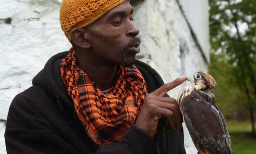 Rodney Stotts holds his falcon, James