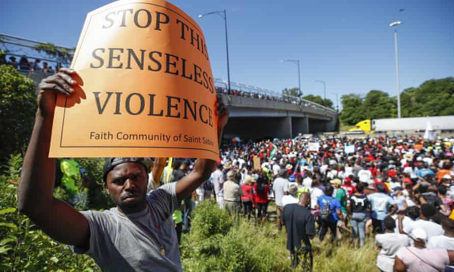 An activist holds a sign during march along Chicago Dan Ryan Expressway on Saturday