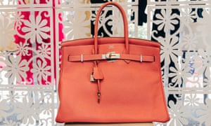 """A bag will fit everybody. There is no size for woman for handbags. They have a great resale value,"" said Elizabeth Murphy, owner of Eleven consignment stores. Shown: Hermes Birkin bag for sale at Michael's"