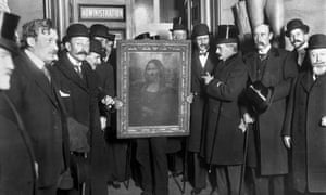 People gather around the Mona Lisa painting on 4 January 1914 in Paris, France, after it was found following its theft in 1911.