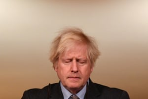 Prime Minister Boris Johnson looks down at the podium during a media briefing in Downing Street on Covid-19.