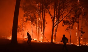 Fire and rescue officers battle a blaze in New South Wales, Australia