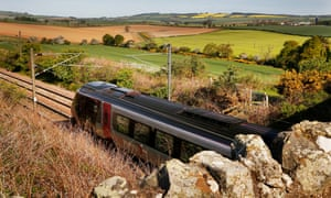A train passes through countryside in Reston, Lincolnshire