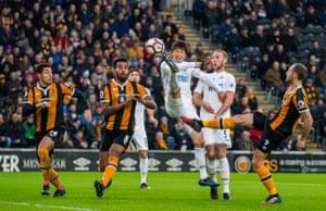 Ki Sung-Yueng of Swansea City takes a shot against Hull City at the KCOM