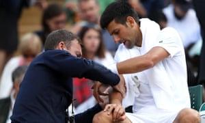 Novak Djokovic of Serbia is given treatment.