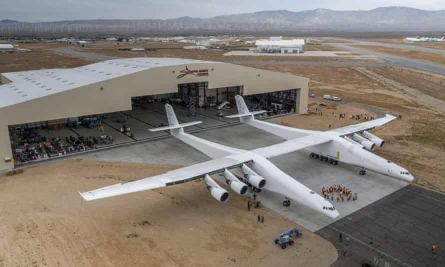 Paul Allen's Stratolaunch plane is pushed out of the hanger for the first time in the Mojave desert, California.